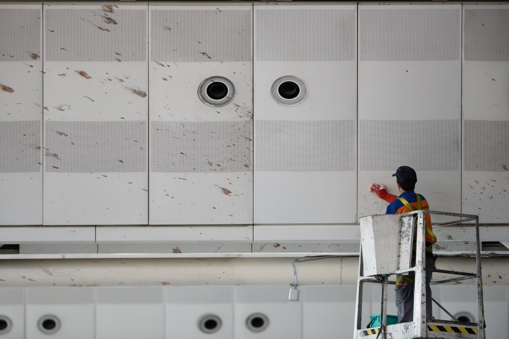 A worker cleaning the blood after the suicide bombing at Istanbul's Ataturk Airport © Akin Celiktas